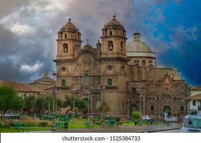 """Cusco / Peru: 01.10.19: Church """"La Catedral"""" in Cusco, Peru, at Plaza de Armas during the golden hour"""