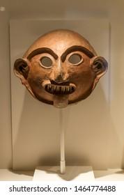 Cusco, Peru - 05/24/2019: Pre Colombian Art Museum mask artifact in Cusco, Peru.