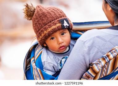 Cusco, Peru - 12 october 2018: Cute peruvian child lookin g into the camera