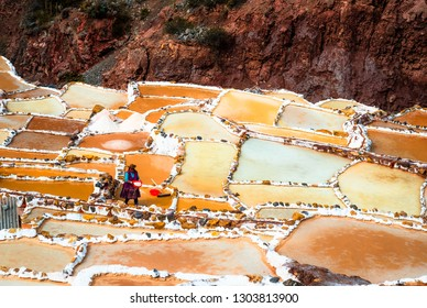 Cusco, Peru - 12 october 2018: Woman at Salinas de Maras near Cusco, salt extraction in Peru