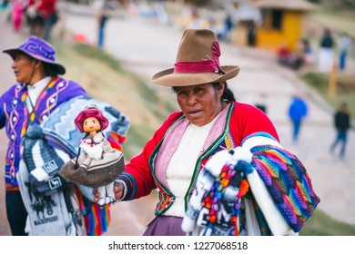 Cusco, Peru - 13 October 2018: woman in colorful national clothing in Sacsayhuaman