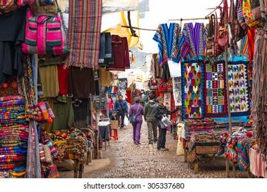Cusco, Peru - 29 APR 2105 European Travellers walking and shopping local Peruvian products, Pisac market,  Scared Valley, Cusco, Peru