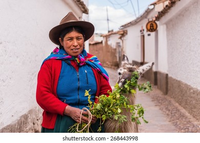 CUSCO, PERU April 07, 2015: A traditionally clothed peruvian woman with a lama
