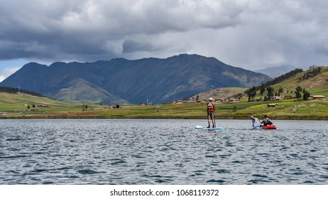 Cusco, Peru - April 2018: Paddleboarding and Kayaking on the Laguna Huaypo lake in the Sacred Valley