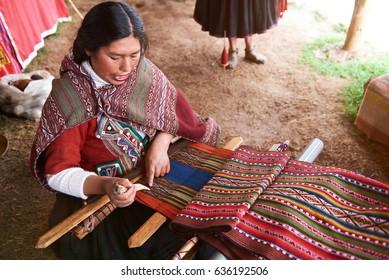 Cusco, Peru -April 21, 2017: Peruvian woman making traditional wool. Woman produce alpaca cloth