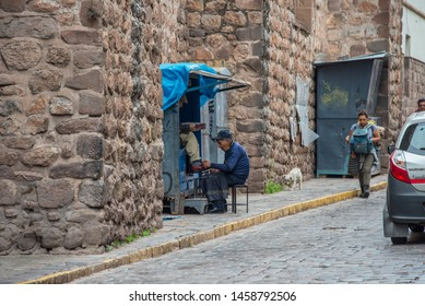 Cusco / Peru: April 30 2019: Shoeshiner on the street in Cusco