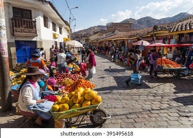 Cusco, Peru - August 08, 2015: People selling and buying fruits at a market in the steets.