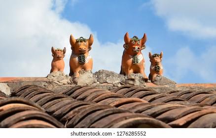 CUSCO / PERU, August 15, 2018: Toritos de Pucara on a roof near Cusco for good luck