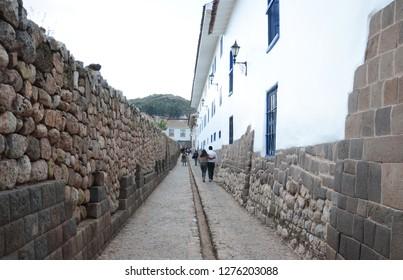 CUSCO / PERU, August 16, 2018: A couple walks down a street in Cusco, Peru