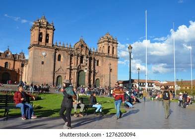 CUSCO / PERU, August 16, 2018: People walk in the Plaza de Armas, Cusco