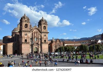CUSCO / PERU, August 16, 2018: Children prepare to practice their dance performance in the Plaza de Armas in Cusco