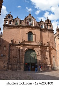 CUSCO / PERU, August 16, 2018: Tourists enter the Temple of the Sacred Family in Cusco.