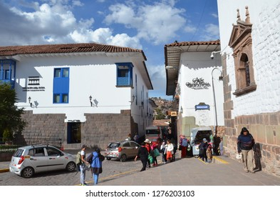 CUSCO / PERU, August 16, 2018: People walk in the plaza in front of the Santo Domingo convent