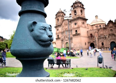 Cusco, Peru, December 26, 2018: Symbol in plaza de armas with blurred cathedral in background