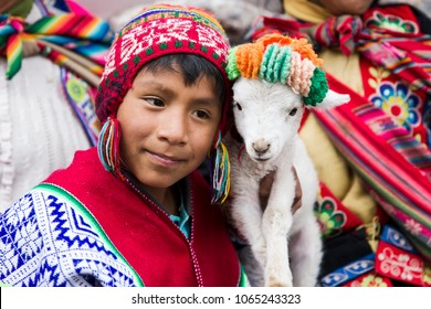 CUSCO, PERU - DECEMBER 31, 2017: Unidentified boy on the street of Cusco, Peru. Almost 29% of Cusco population have less than 14 years.