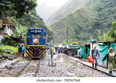 CUSCO, PERU - JAN 27: Rainy day for tourists on the way to Aguas Calientes, host city to Machu Picchu, on January 27, 2017. January to March is wet season in Cusco.