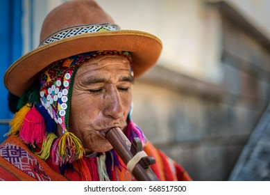 CUSCO, PERU - JAN 30: A Quechuan man playing a pinkullo on January 30, 2017. The wood instrument is similar to a flute.