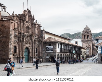 Cusco, Peru - January 2, 2017. Side view of the Plaza de Armas in Cusco with the Paraninfo Universitario and the Basilica de la Merced church