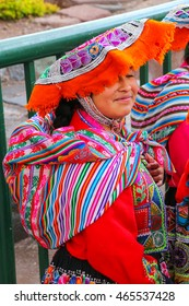 CUSCO, PERU - JANUARY 20: Unidentified woman in traditional dress stands in the street on January 20, 2015  in Cusco, Peru. In 1983 Cusco was declared a World Heritage Site by UNESCO.