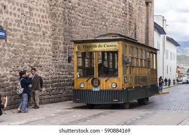 CUSCO, PERU - JANUARY 23,2017: Tourist bus stylized vintage tram in old town Cusco. Declared a World Heritage Site by UNESCO in 1983