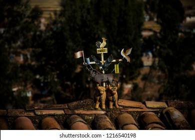 Cusco, Peru - July 2, 2018: Crafts of Torito de Pucará on the roof of the houses of Cusco. The bulls are a symbol of protection and a fable in South America.