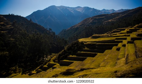 Cusco, Peru - July 2, 2018: green hills in the city of Pisac in the Sacred Valley of the Incas, next to the majestic Inca ruincas, the greatest example of Inca architecture.