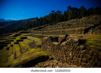 Cusco, Peru - July 2, 2018: Majestic Inca ruins of the city of Pisac on a green hill in the Sacred Valley of the Incas. It is one of the greatest examples of Inca architecture.