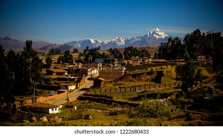 Cusco, Peru - July 2, 2018: Houses of the city of Racchi surrounded by trees of the plateau of Chinchero and as background the Cordillera de los Andes. Landscapes to enjoy.