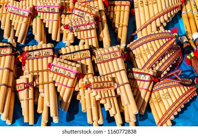 CUSCO, PERU - JULY 25, 2018: Traditional Andes pan flutes or panpipes on a market stall in Cusco, Peru. It is a traditional music instrument that can be found in Peru, Ecuador and Bolivia.
