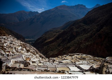 Cusco, Peru - July 7, 2018: pre-Inca traditional salt mine ponds in Maras located in the Urubamba in the Andes mountain range. One of the main tourist attractions in Cusco.