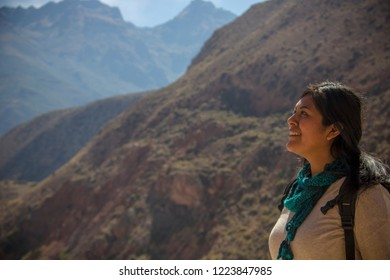 Cusco, Peru - July 7, 2018: beautiful tourist observed astonished the beautiful landscape of the Urubamba Valley and the Andes mountain range.