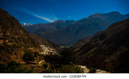 Cusco, Peru - July 7, 2018: mountains of the Cordillera de los Andes, next to the greenish plateau of the Sacred Valley. View from the city of Maras, beautiful landscape to enjoy.