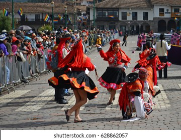 CUSCO, PERU - JUNE 23 2013: People in traditional dress in the city center of Cusco participating with the Inti Raymi festivities with tourists and locals watching the dances.