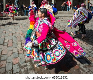 CUSCO, PERU - JUNE 23, 2013: Young indigenous Quechua woman in traditional clothing during the Inti Raymi or sun festival on the Plaza de Armas of Cusco.