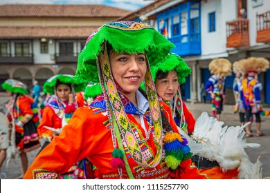 CUSCO, PERU - JUNE 24, 2013: A middle aged woman of Peruvian ethnicity smiling in traditional costume and hat during the Inti Raymi Sun Festival on the Plaza de Armas of Cusco, Peru, South America.