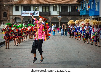CUSCO, PERU - JUNE 24, 2013: Young Quechua male dancer performing during the Inti Raymi Sun festival in traditional clothing and hat on the Plaza de Armas, main square of the city.