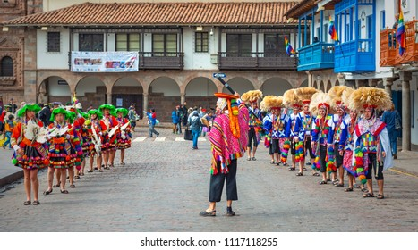 CUSCO, PERU - JUNE 24, 2013: A group of Peruvian Quechua indigenous in traditional clothing participating with the Inti Raymi Sun Festival on the Plaza de Armas or main square of the city.