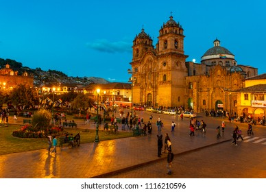 CUSCO, PERU - JUNE 25, 2013: Big affluence at the Plaza de Armas, the main square of Cusco city with its lovely cathedral after sunset during the blue hour and blur motion of people.