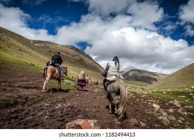 Cusco, Peru- March 18, 2017:People hiking on Vinicunca aka Rainbow Mountain in the region of Cusco, Peru
