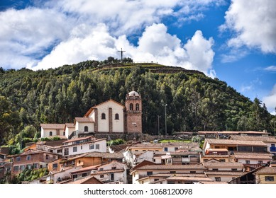 Cusco, Peru - March 29, 2018: The Church of San Cristobal overlooks the city, in front of Cristo Blanco and the Inca site of Sacsayhuaman