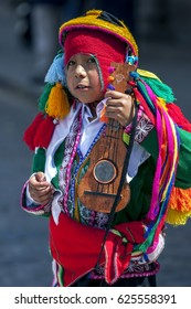 CUSCO, PERU - MAY 1, 2012 : A portrait of a boy in Peruvian costume at Plaza de Armas during the May Day parade.