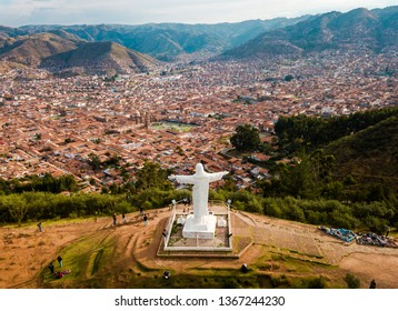 CUSCO, PERU: November 21, 2017 Aerial of the White Christ monument with Cusco in the background