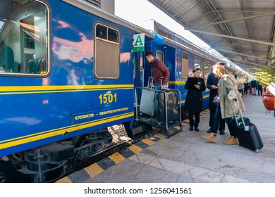 Cusco, Peru - Sep 13, 2018: Tourists boarding a train to Machu Picchu at a railway station in Cusco