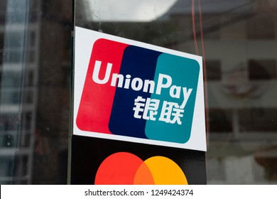 Cusco, Peru - Sep 15, 2018: Close-up view of UnionPay sign outisde a restaurant in Peru. It is the largest card payment organisation in the world, ahead of Visa and Mastercard.