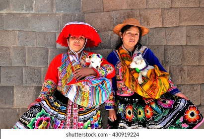 CUSCO, PERU - SEPTEMBER 8, 2014: Quechua Indian girls in the traditional colorful clothes, Cusco ,Peru