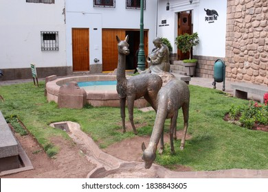 Cusco/Peru - October 3, 1990: A statue of a women pouring water into a fountain with two llamas statues near by in Cusco, Peru