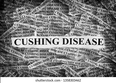 Cushing Disease. Torn pieces of paper with the words Cushing Disease. Concept image. Black and White. Close up.