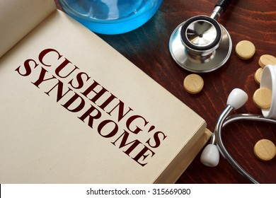 Cushings syndrome  written on book with tablets. Medicine concept.