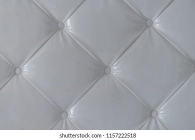 Cushion design of white colored leather interior.