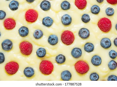 custard with blueberries and raspberries, background